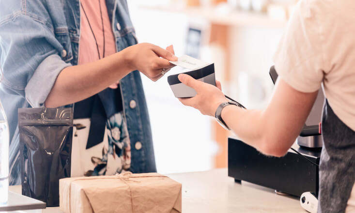 Women paying for goods with credit card